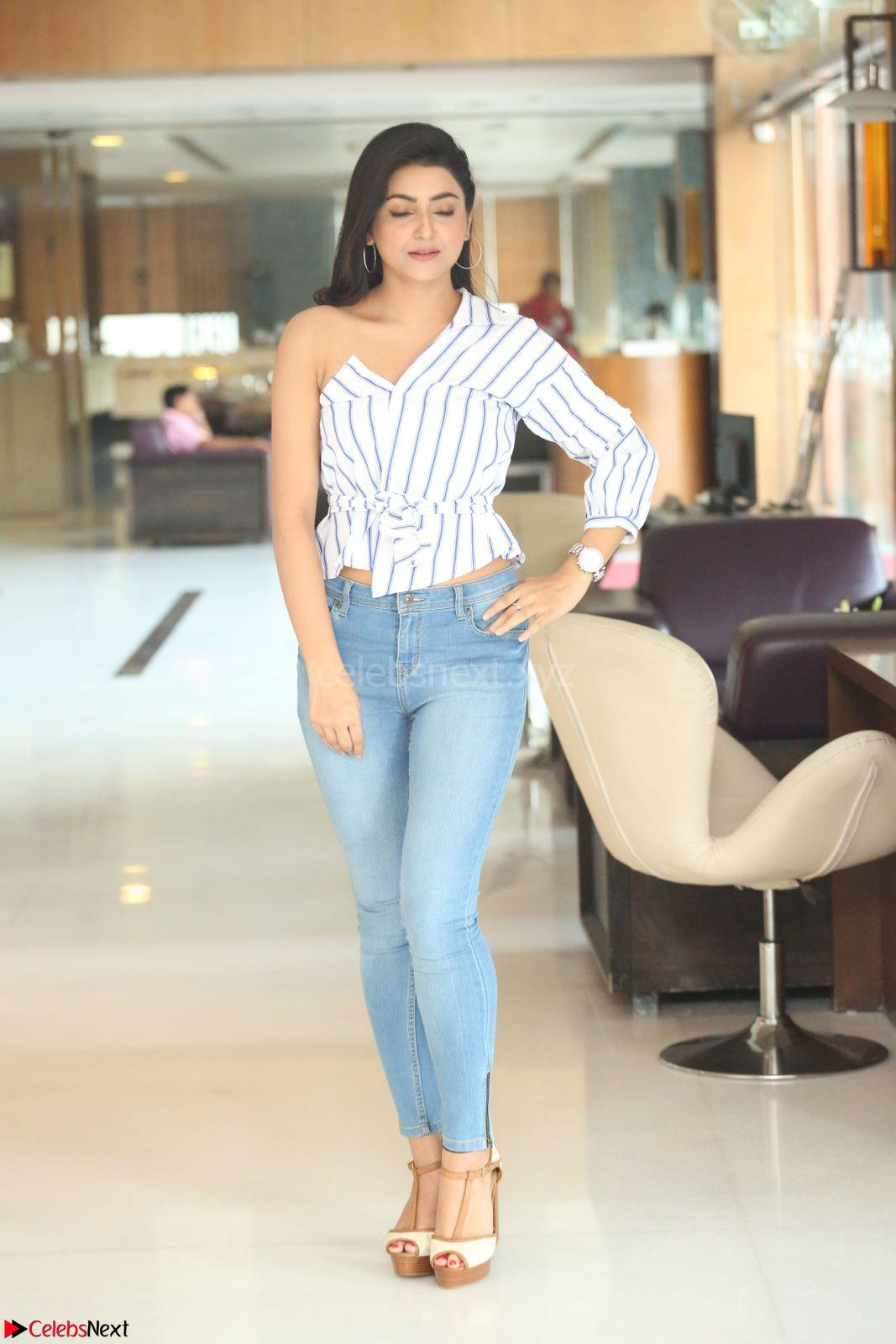 Avanthika Mishra in One Shoulder Crop Top and Denim Jeggings at At Vaishakham Movie Press Meet ~ CelebsNext Exclusive
