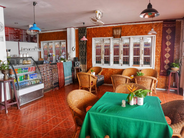 seating area and tables inside Vela cafe and restaurant vang vieng laos