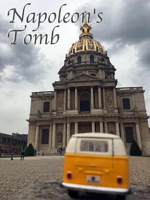 Title card with yellow van outside Napoleon's tomb