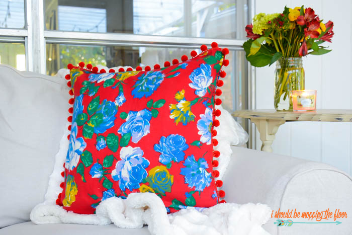 Vintage Fabric Pom Pom Pillow | Make this cute, envelope, pom pom pillow with this simple-to-follow tutorial (she used a vintage Joan Kessler fabric, but any fabric will work!).
