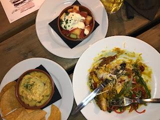flatlay image of patatas bravas, hummus and katsu curry