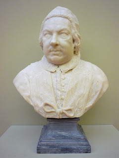 The 18th century bust of Benedict XIV by  Pietro Bracci is in the Museum of Grenoble