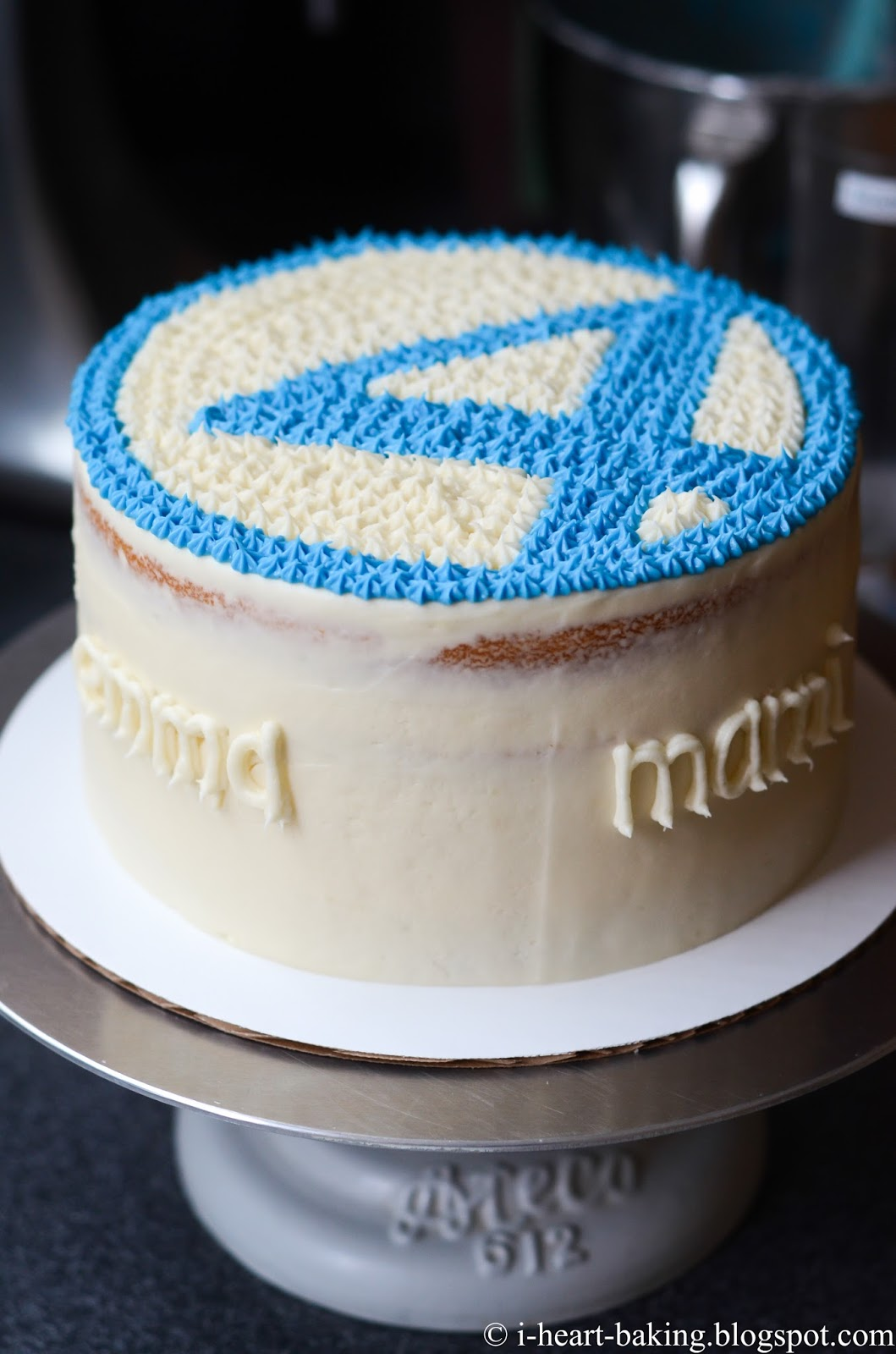 The Frosting With Royal Blue Food Coloring And Used A Medium Star Tip To Fill In The Rest Of The Fantastic Four Logo As Well As The Sides Of The Cake