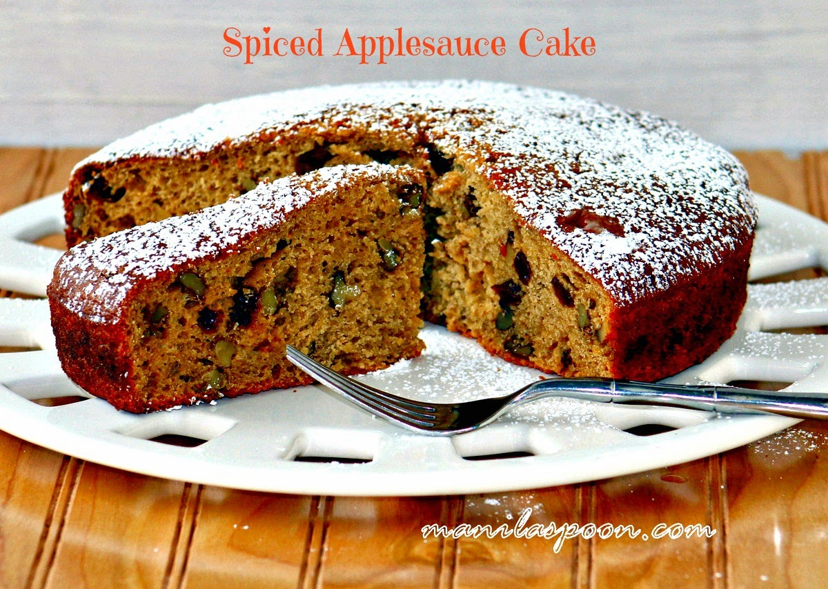 No oil or butter is used in this cake yet it comes out so moist and tasty! Perfectly spiced with cinnamon and nutmeg with added fruity goodness from raisins and crunch from walnuts, it's the perfect cake for coffee or tea time! #applesauce #cake #sweets #desserts #lowfat #nobutter