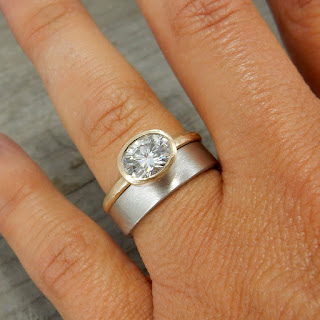 gold moissanite engagement ring