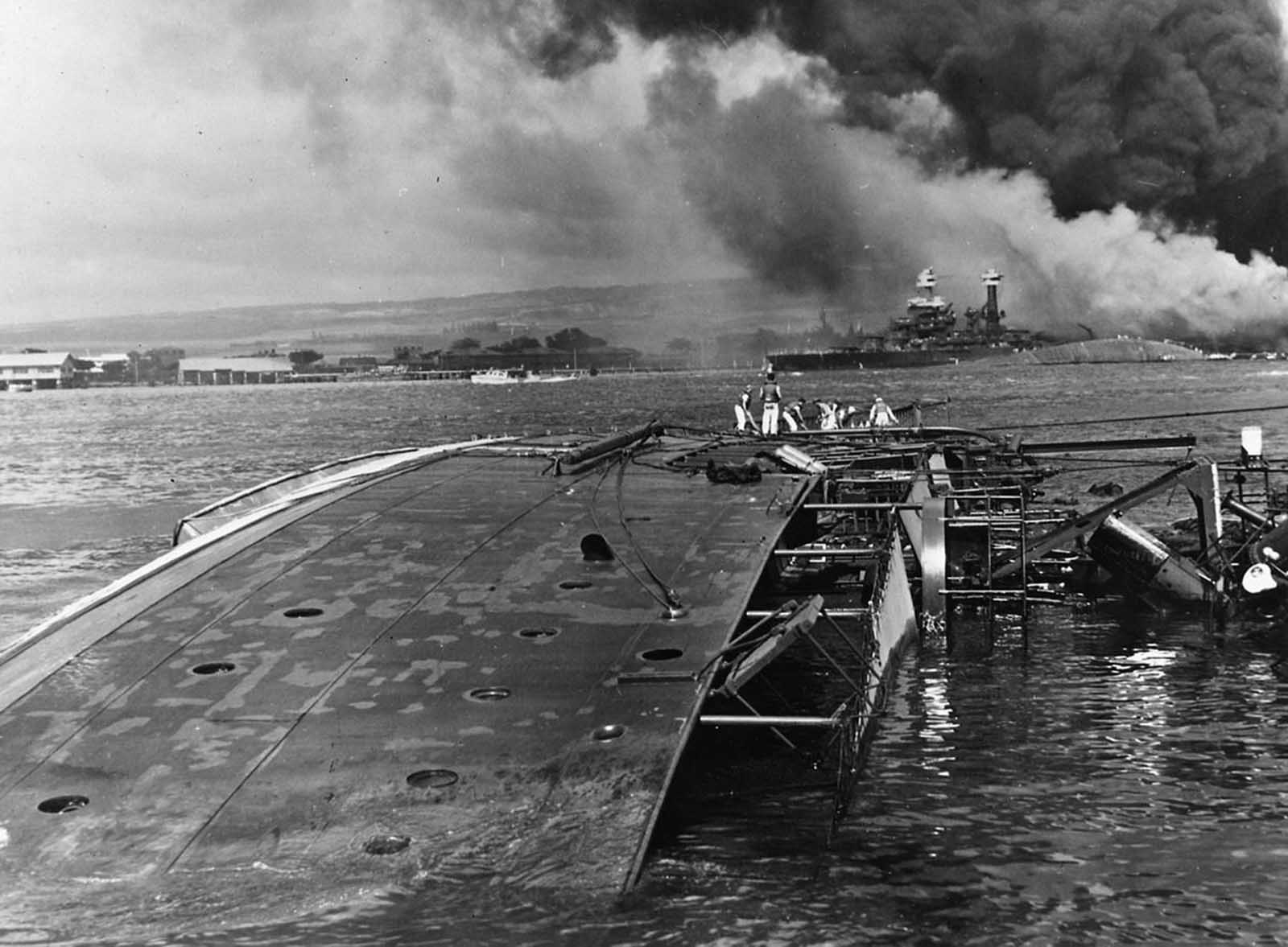 The minelayer USS Oglala lies capsized after being attacked by Japanese aircraft and submarines in the attack on Pearl Harbor.