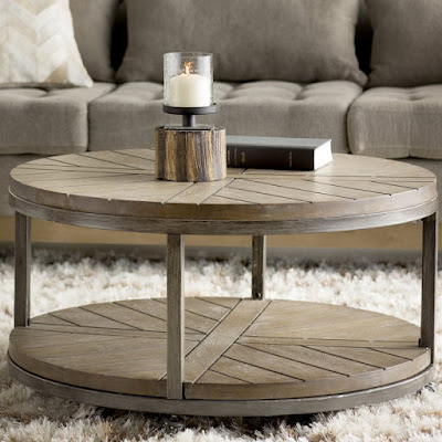Round rustic wood and metal coffee table with modern farmhouse style - found on Hello Lovely Studio