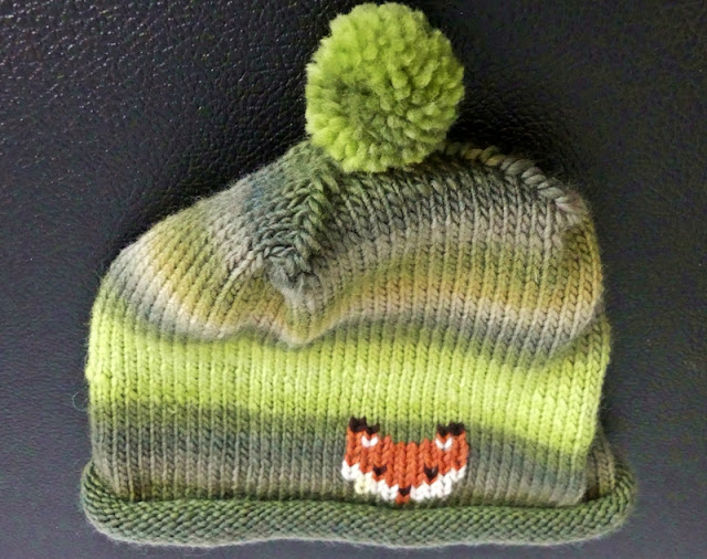 Green Grey Fox knit hat designed by Minaz Jantz