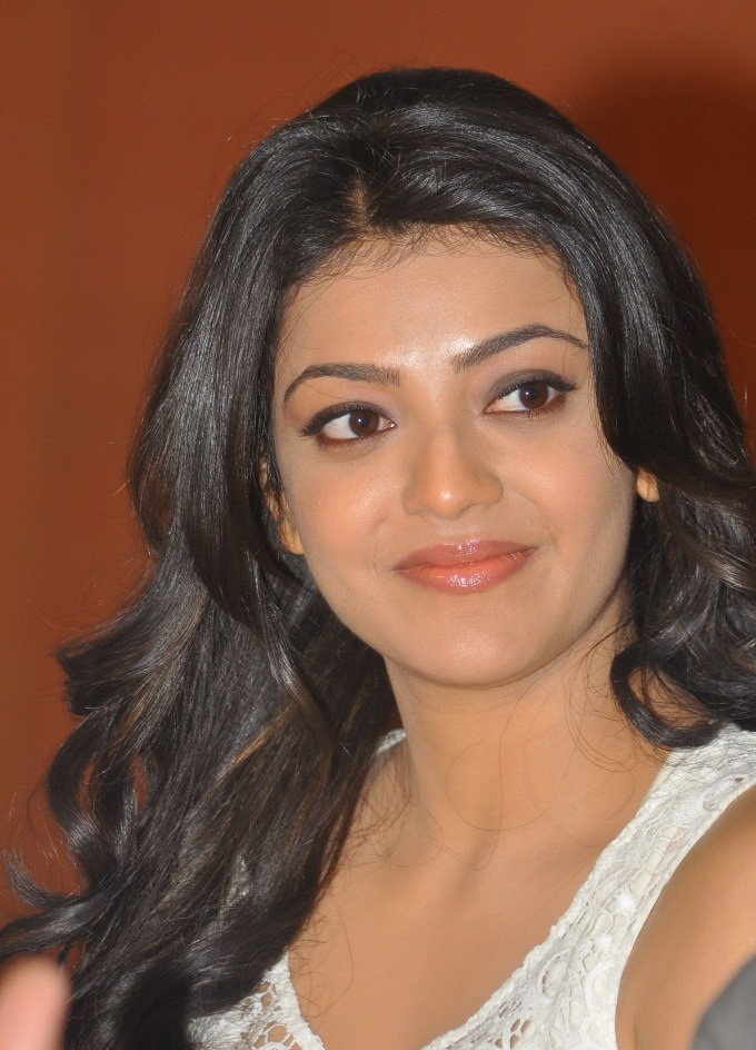 Tollywood Actress Kajal Aggarwal Hot Smiling Face Closeup In White Top