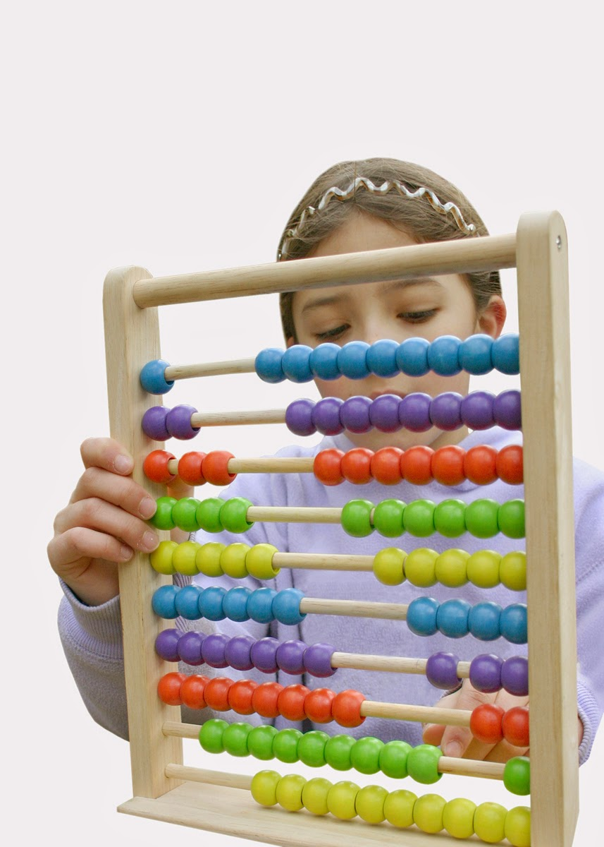 Young girl playing with an abacus