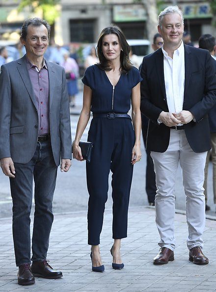 Queen Letizia wore Mango a blue zip-detail jumpsuit, Carolina Herrera navy pumps. diamond leaf earrings at famelab
