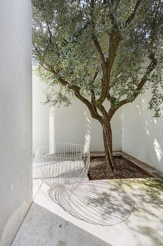 escultura de metal para jardin