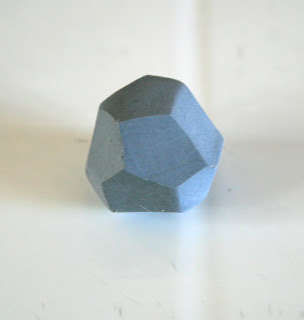 A faceted polymer clay bead