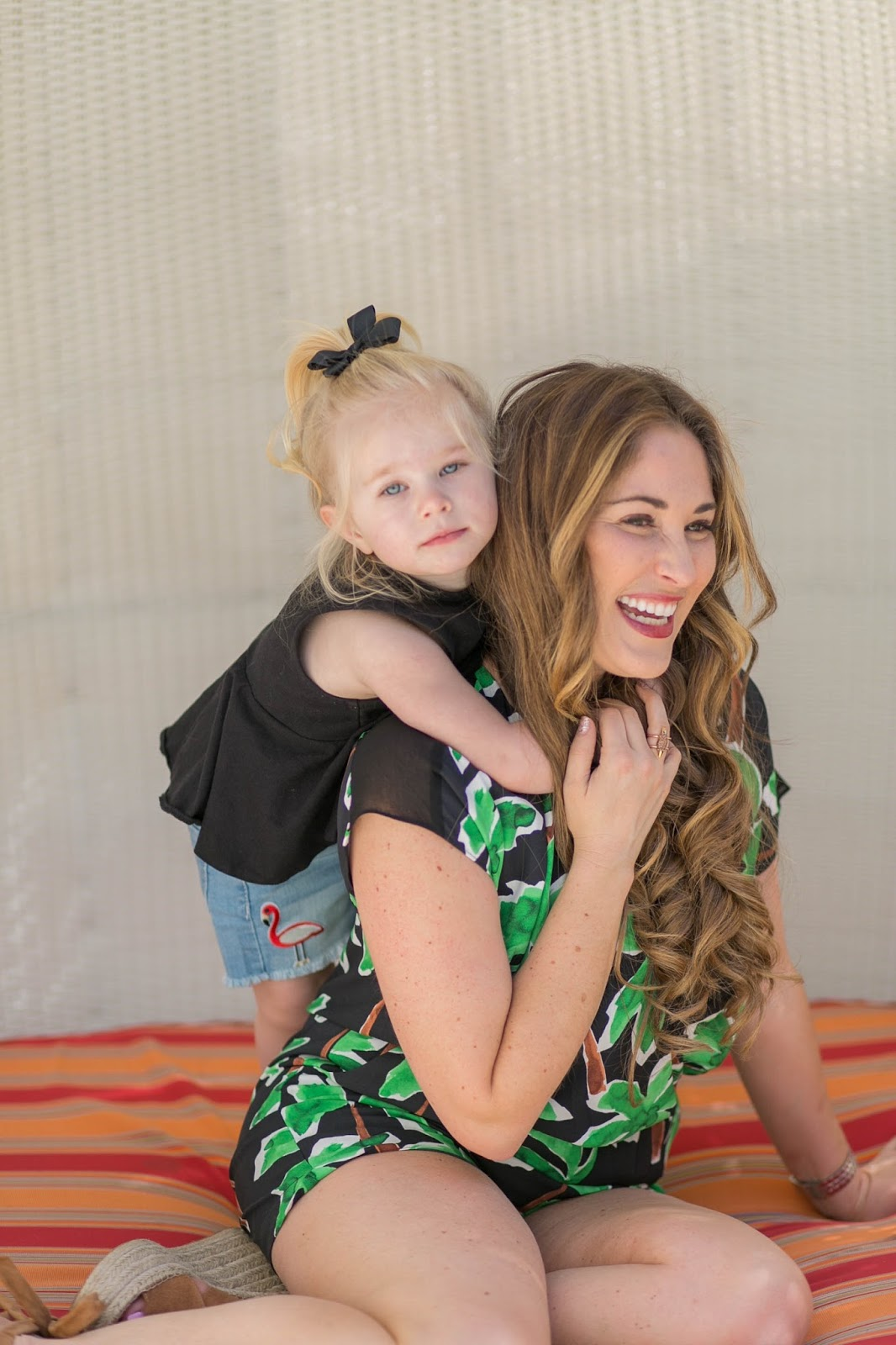 The Ultimate Packing List for Kids - 9 Must Haves When Traveling with a Child by lifestyle blogger Laura from Walking in Memphis in High Heels