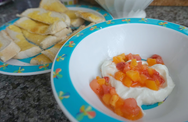 plate of toast fingers and bow of fruit and yoghurt
