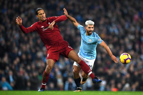 Liverpool defender Virgil Van Dijk tackles Manchester City striker Sergio Aguero