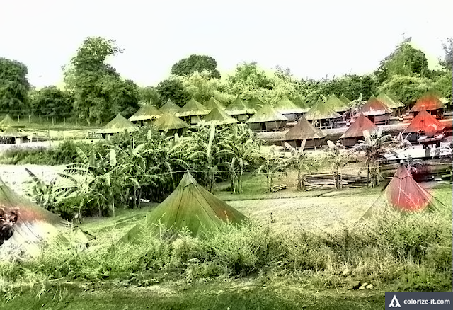 Tents sprung up at Sub-base R in Batangas.  Image source:  United States National Archives.  Colorized courtesy of Algorithmia.