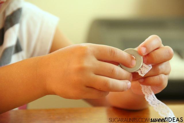 Use yarn and washers to create fun jewelry in this creative process art kids'craft.