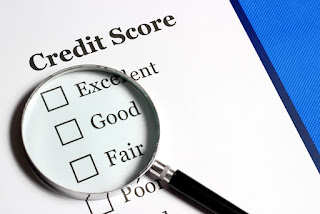 magnifying class showing credit scores