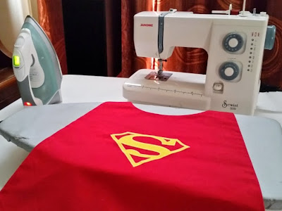 Ironing and finishing the Superman cape