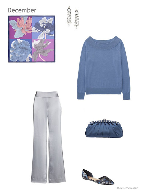 a blue sweater with silver satin pants