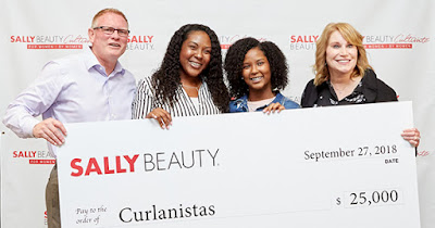 Founders of Curlanista receiving the Sally Beauty Cultivate Award