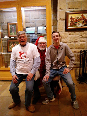 2 big kids on Santa's lap at Bushy Run Battlefield