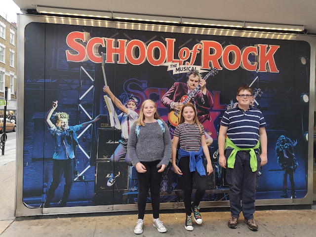 Kids outside school of rock theatre