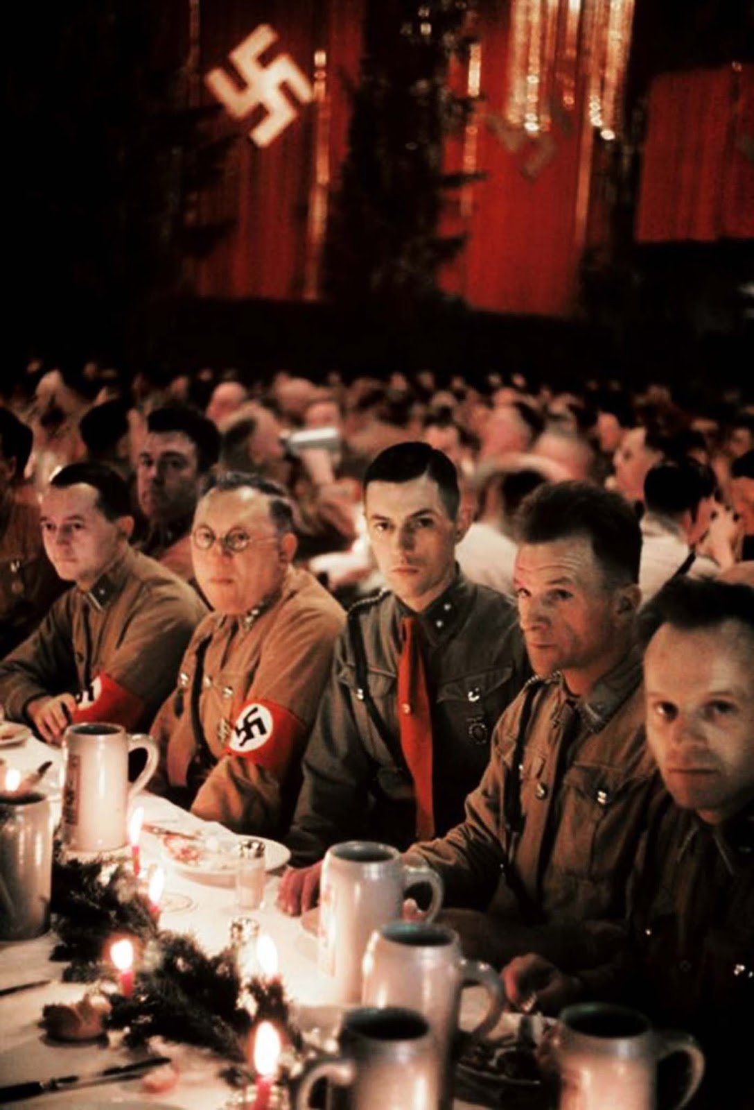 Waffen SS (or Schutzstaffel) officers cadets sit at a long table during a Christmas party.
