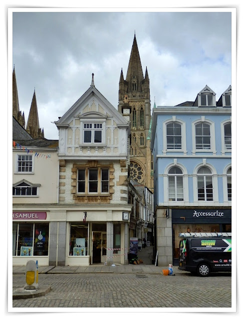 Truro Cathedral overlooking shops in Truro, Cornwall