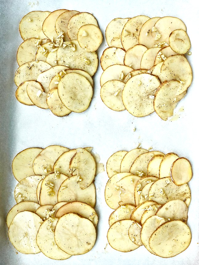 Thinly sliced russet potatoes and garlic