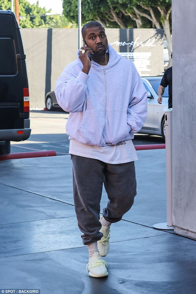Kanye West spotted out solo on Black Frday