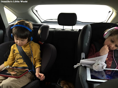 Children in car on iPads