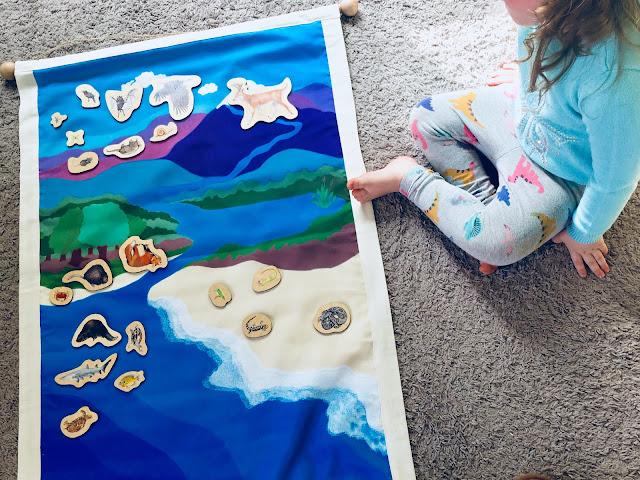 Montessori child using Waseca Biomes Air, Land, and Water Mat