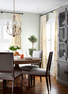 Wonderful Rounded Wooden Dining Room Tables And Chairs under the Small Iron Chandelier above Hardwood Floor