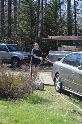 Sarah washing the car