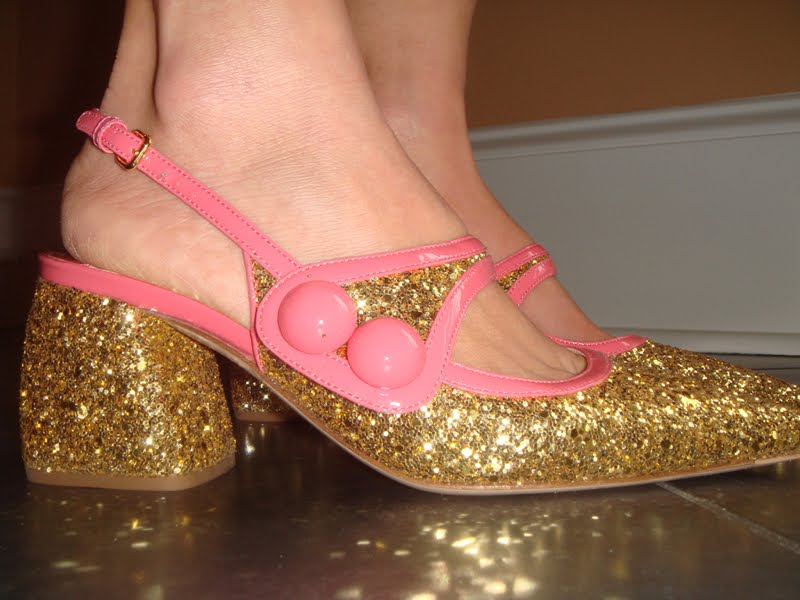 Up close side view of the gold glitter shoes with pink patent trim.