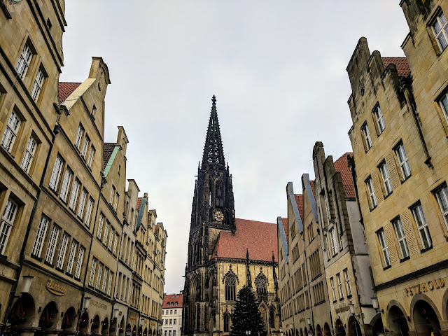 The main shopping street and church spire in Muenster, Germany in the North Rhine-Westphalia region
