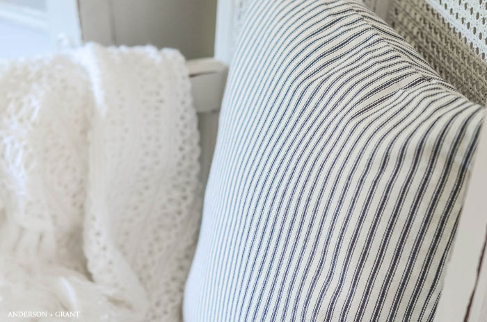 One of the easiest sewing projects you can try is making a pillow.   This tutorial teaches how to make an envelope pillow cover which requires just  some simple cutting and a few straight stitches.   #DIY #sewingbasics #farmhousediy #pillow #tutorial