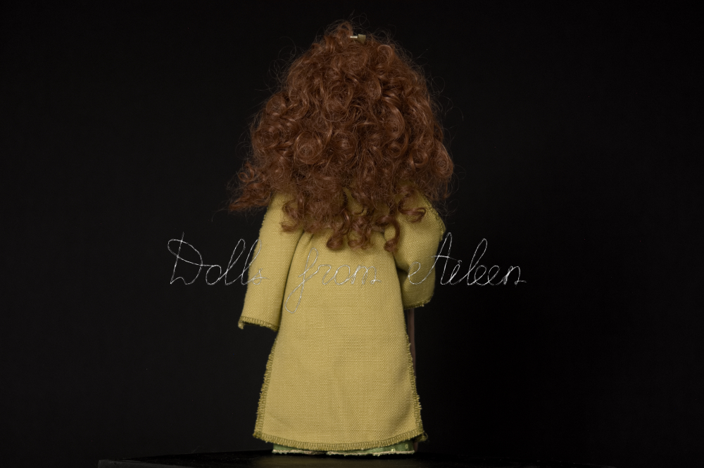 OOAK Celtic witch doll with curly hair, view from behind