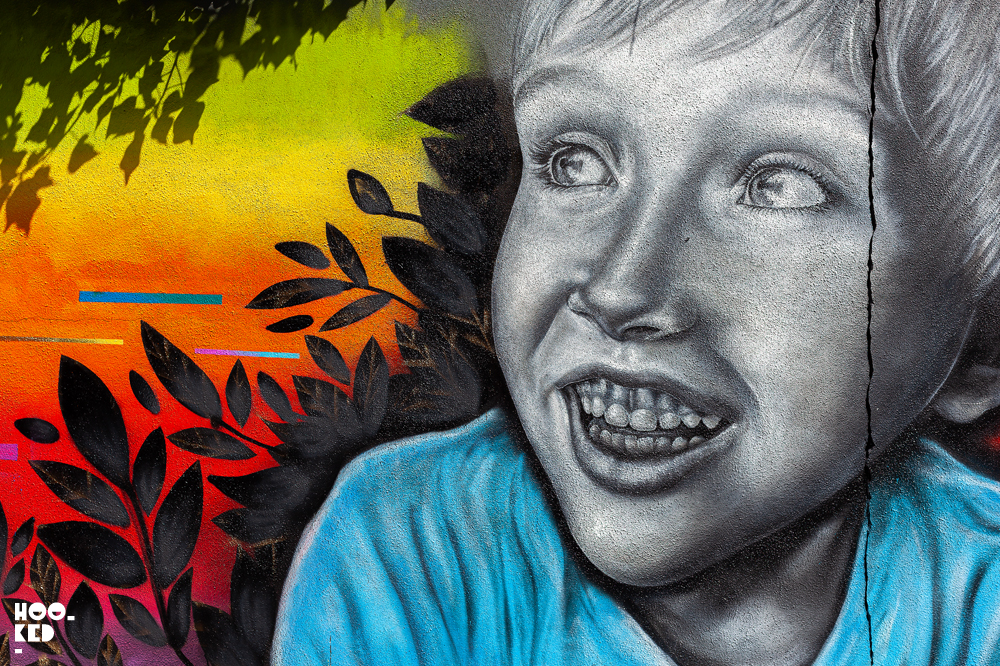 Waterford street art festival, smiling boy mural by Irish artist Caoilfhionn Hanton