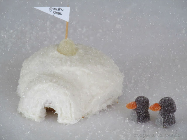 gumdrop penguins and a cake and doughnut igloo
