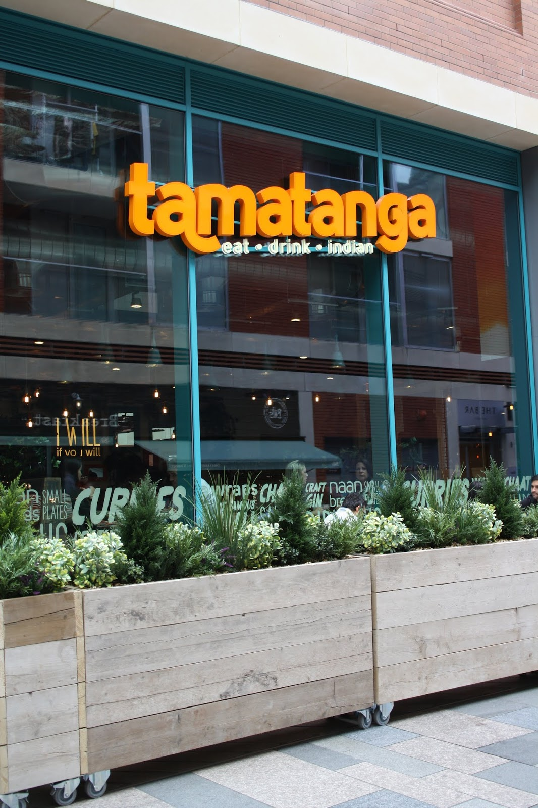 The exterior of the Tamatanga restaurant at Highcross, Leicester, with the establishment's name on a big orange sign