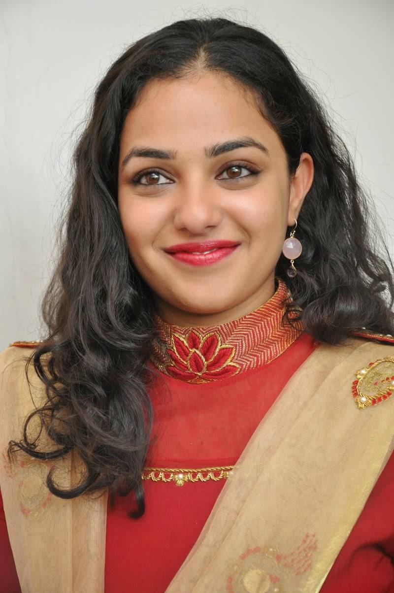 Telugu Girl Nithya Menen Hot Beautiful Smiling Face Close Up Photos In Red Dress
