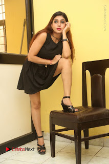 Tollywood Upcoming Actress Pooja Roshan Stills in Black Short Dress at Plus 1 Movie Trailer Launch  0199.JPG