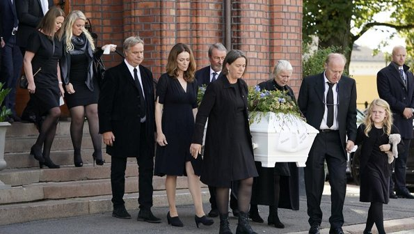 Funeral of Norwegian musician Anne Grete Preus, held at Uranienborg Church in Oslo. Black v-neck half sleeve midi dress