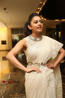Actress Rakul Preet Singh Stills in White Dress at Winner Pre Release Function  0021.jpg