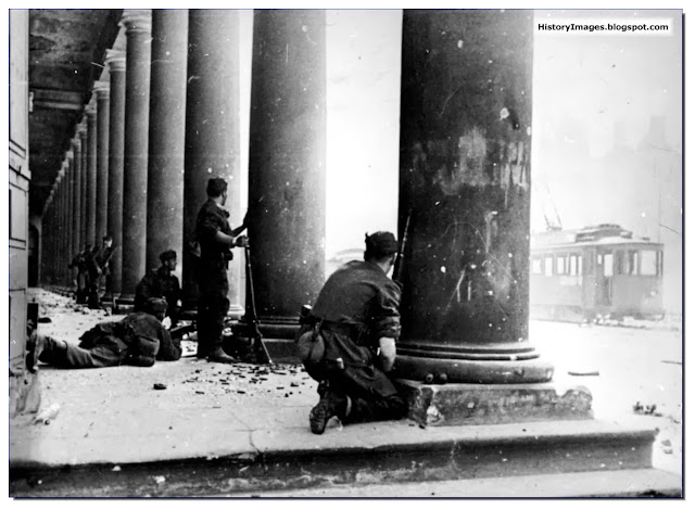 Warsaw Uprising 1944 German soldiers hiding behind pillarse Grand Opera Warsaw  crush  uprising