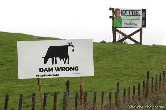 Anti-dam sign, Te Aute Hill, SH2, Te Aute, Central Hawke's Bay. Dam wrong, #StopRuataniwha, Greenpeace. Near a Paula Fern for Ruataniwha ward, Central Hawke's Bay District Council election hoarding. photograph