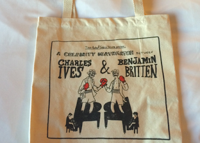 tote bag with cartoon image of Charles Ives and Benjamin Britten facing off in a 'celebrity death match'